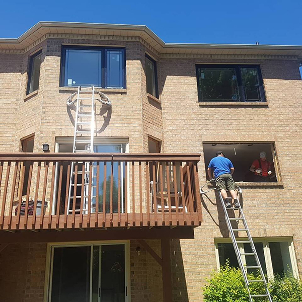 canpro team installing new windows and patio doors in custom home - patio door replacement toronto