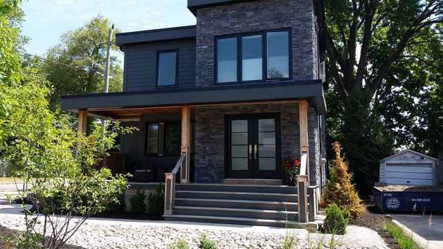 modern home with new front door and windows - canpro windows and doors ajax